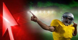 Spieler des amerikanischen Fußballs mit Stadionsübergang und Pfeil, die oben zeigen Stockfotos