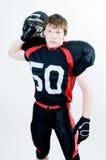Spieler des amerikanischen Fußballs mit Sturzhelm Lizenzfreies Stockfoto