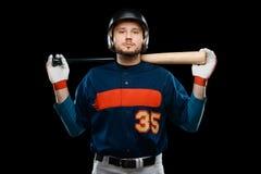 Spieler des professionellen Baseballs auf Schwarzem stockfotografie