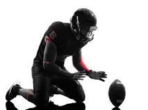 Spieler-Landungsfeierschattenbild des amerikanischen Fußballs Stockfotos