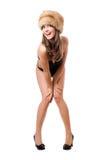 Spielerische Dame tragender Badeanzug und Pelzkappe lizenzfreies stockbild