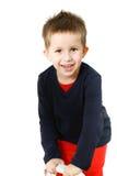 Spielerisches Lächeln des kleinen Jungen lizenzfreies stockbild