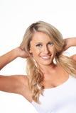 Spielerisches schönes blondes Modell, lokalisiert auf Weiß Stockbilder