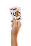Spielkarten in der Hand lokalisiert auf weißem Hintergrund Stockfotografie