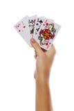 Spielkarten in der Hand lokalisiert auf weißem Hintergrund Stockbild