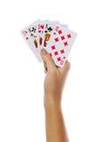 Spielkarten in der Hand lokalisiert auf weißem Hintergrund Lizenzfreie Stockfotografie