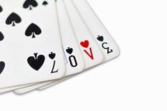 Spielkarten mit schriftlicher Liebe Lizenzfreies Stockbild