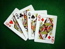 Spielkarten und Schürhaken Stockbilder