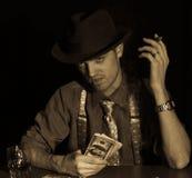 Spielkartespiel des Mannes Stockfoto