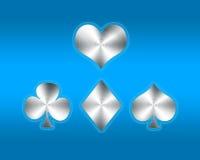 Spielkartesymbole auf blauem Hintergrund Stockbild