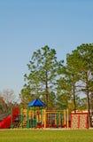 Spielplatz durch Pines Lizenzfreies Stockbild