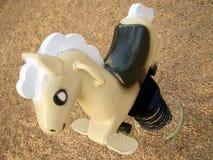 Spielplatz-elastisches Pferd Stockfoto