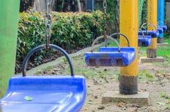 Spielplatz-Schwingen Stockfotos