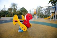 Spielplatzschaukelpferd Stockbilder