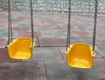 Spielplatzschwingen Stockbilder