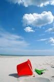 Spielwaren auf Strand Stockfoto
