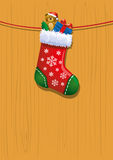 Spielwaren im Weihnachtsstrumpf Stockfoto