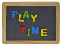 Spielzeit in farbigen Buchstaben auf Schiefer Stockbilder
