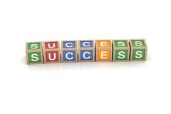 Spielzeug-Block mit Erfolgs-Wort Stockfoto