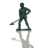 Spielzeug-grüner Armee-Mann (Gruben-Kehrmaschine) stockfoto
