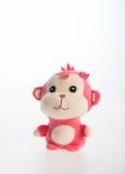 Spielzeug oder weiches Spielzeug des Affen auf dem Hintergrund Lizenzfreies Stockbild