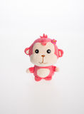 Spielzeug oder weiches Spielzeug des Affen auf dem Hintergrund Stockbild