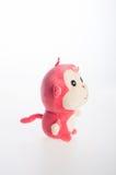 Spielzeug oder weiches Spielzeug des Affen auf dem Hintergrund Lizenzfreies Stockfoto