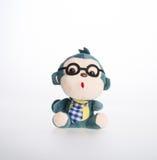 Spielzeug oder weiches Spielzeug des Affen auf dem Hintergrund Lizenzfreie Stockfotos