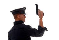 Spielzeug-Polizeibeamte mit Gewehr Stockbild