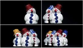 Spielzeug-Schneemann auf Schwarzset Stockbilder