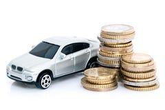 Spielzeugauto und Euromünzen Lizenzfreies Stockbild