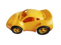 Spielzeugautogelb lokalisiert auf weißem Hintergrund Lizenzfreies Stockbild