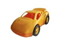 Spielzeugautogelb lokalisiert auf weißem Hintergrund Stockfotografie