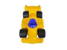 Spielzeugautogelb lokalisiert auf weißem Hintergrund Lizenzfreies Stockfoto