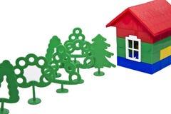 Spielzeugbäume und -haus Lizenzfreies Stockfoto