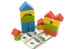 Spielzeugblock und -geld Lizenzfreie Stockbilder