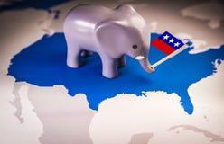 Spielzeugelefant, der eine Flagge der republikanischen Partei hält Lizenzfreie Stockfotos