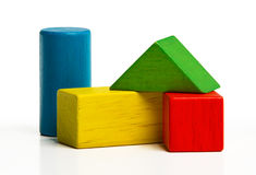 Spielzeugholzklötze, Mehrfarbenziegelsteine Stockfoto