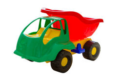 Spielzeuglastwagen auf hölzernem Hintergrund Lizenzfreie Stockbilder