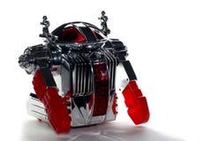 Spielzeugroboter in der Hintergrundbeleuchtung Stockfotos