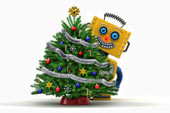 Spielzeugroboter glücklich mit Weihnachtsbaum Lizenzfreies Stockfoto