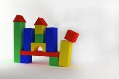 Spielzeugschloss von den Farbblöcken auf einem weißen Hintergrund Stockfotografie