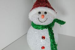Spielzeugschneemann mit mehrfarbiger Beleuchtung Weihnachts- und des neuen Jahresdekoration Stockbilder