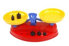 Spielzeugskalen mit Gewichten Stockfotos