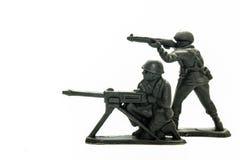 Spielzeugsoldaten über Weiß lizenzfreies stockbild