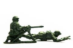 Spielzeugsoldaten über Weiß lizenzfreie stockfotografie