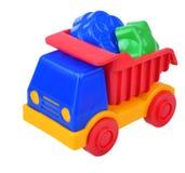 Spielzeugstrand-LKW mit Sandformen Stockfotos