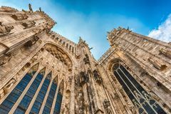 Spiers and statues on the gothic Cathedral of Milan, Italy Stock Images