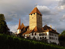 Spiez Castle 04, Switzerland. The medieval castle of Spiez set on a spur on the Lake Thunersee in central Switzerland, a short time before sunset during a rainy Stock Photography