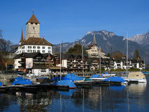 Spiez Castle and marina 03, Switzerland. The medieval castle of Spiez set on a spur on the Lake Thunersee in central Switzerland and the small harbor at its base Royalty Free Stock Photos